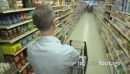 Pushing a shopping cart in a grocery store (4 of 4) 21267