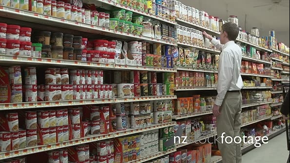 Employee re-stocking shelves 21275