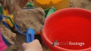 Kids shoveling sand in a sandbox, Kindergarten 22466