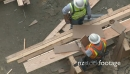 Construction workers take measurements 23544