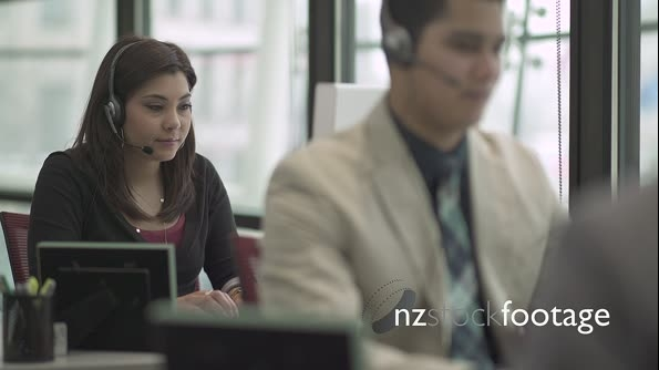 A Mixed Race Woman Works in a Attractive Modern Call Center (2 of 6) 23798