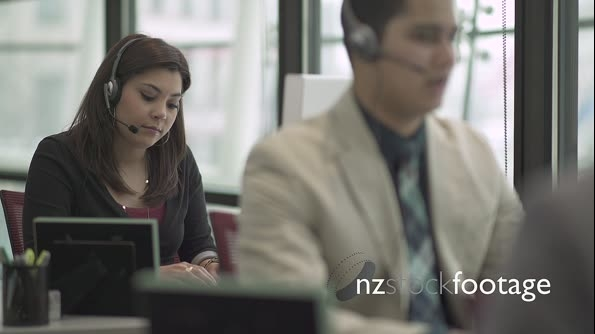 A Mixed Race Woman Works in a Attractive Modern Call Center (6 of 6) 23799