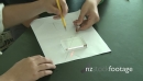 Student drawing square on paper 23835