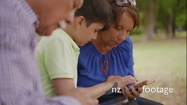 14-Child Helping Grandma Text Messaging On Mobile Phone 24131