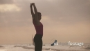Slow motion Fitness Active Girl Stretching On Beach 24365