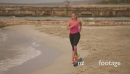 Active Girl Doing Fitness Running On Beach 24369