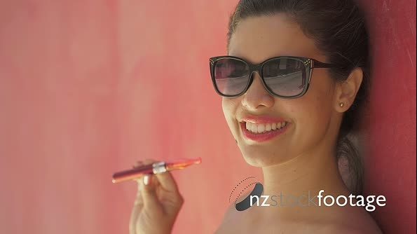 Slowmotion Girl Smokes Electronic Cigarette E-Cig Against Red Background 24465