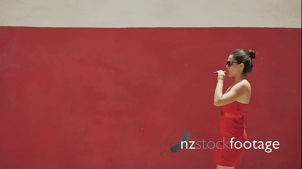 Slowmotion Woman In Red Clothes Smokes Electronic Cigarette E-Cig 24467