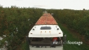 Truck lift over apples aerial HD 25009