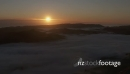 Sun rise over foggy valley HD 25326