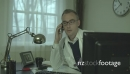 Doctor on phone at his office desk 25521