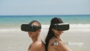 Teenagers Girlfriend Boyfriend Playing Virtual Reality On Beach 25529
