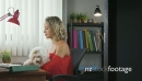 3-Office Woman Holding Dog During Skype Conference Call 25596