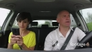 Couple Smiling In Car Playing Pokemon Go With Smartphone 25626