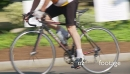Close-up of cyclist riding through town 26469