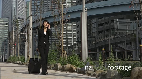 Slow Motion Asian Businesswoman Talking On Telephone Traveling With Baggage 26648