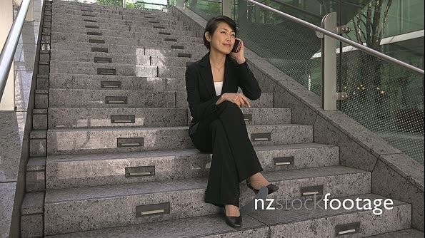 Portrait Of Happy Beautiful Asian Female Manager With Mobile Telephone 26649
