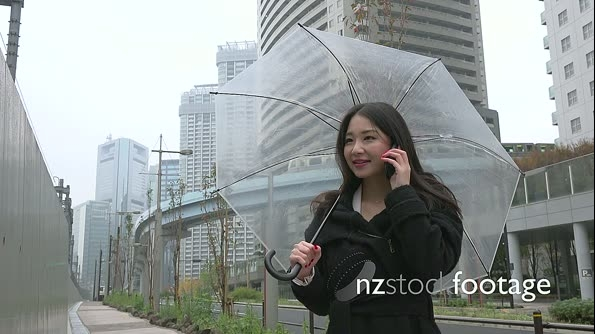 Beautiful Asian Woman Talking On Mobile Phone With Umbrella 26676