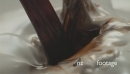 Coffee pouring into milk in slow motion 26690