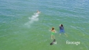 Aerial of swimmer in the ocean with shimmering water 26724