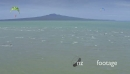 Aerial of Kitesurfers surfing in front of rangitoto island Auckland New Zealand 26749