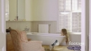 Woman taking bath in domestic bathroom 26854