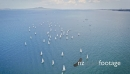 Aerial flying over small sailing boat competition in auckland 26944