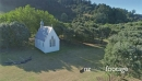 Aerial flying over historic church in Man o'war Bay, waiheke island, New Zealand 26996