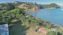 Aerial flying over calm beach in Man o'war Bay, waiheke island, New Zealand 27040