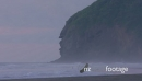 people going for a swim on piha beach at sunset, Auckland, New Zealand 27369