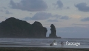 people walking on piha beach at sunset, Auckland, New Zealand 27370