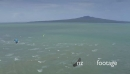 Aerial of Kitesurfers surfing in front of rangitoto island Auckland New Zealand 27372