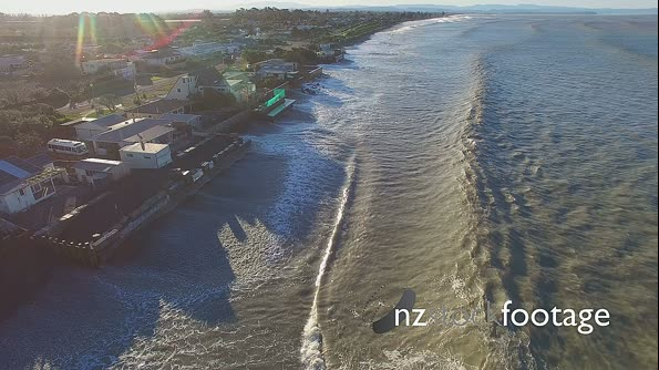 Aerial view of storm waves hitting coastal properties 28104