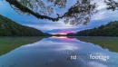 Beautiful time-lapse of a sunset and mountain range reflected in a still lake, in New Zealand 28305