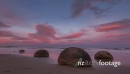 Coastal sunset scene with round rock bolders at Moeraki 28307