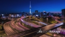 Vibrant night to day time lapse at rush hour over highway and Auckland city 28341