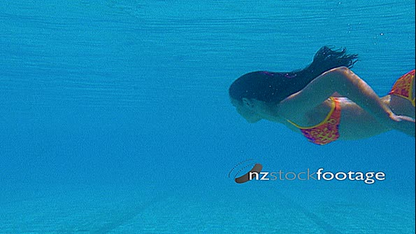 Woman Swimming Underwater Water in Pool 28444