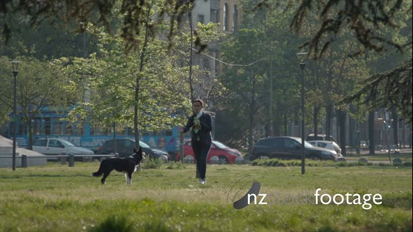 Italian Woman Playing With Her Dog Pet In Park 29289