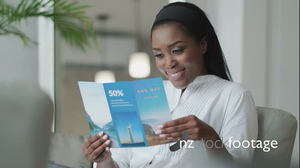 01 Black Woman Reading Travel Flyer And Planning Holidays Trip 29363