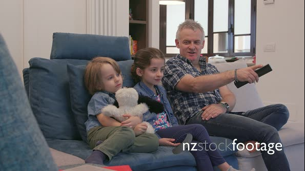 1 Happy Family Man With Children Watching Movie On TV 29376