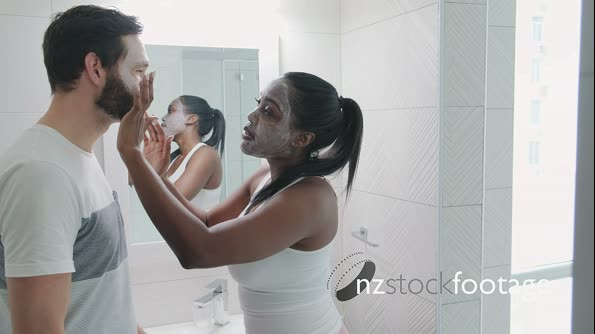 15 Woman Applying Beauty Mask And Skin Cleanser To Man 29390