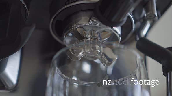 Close up of espresso coffee machine portafilter brewing extracting double shot into glass 29859