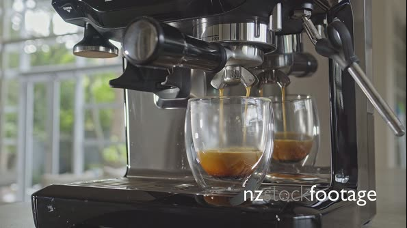 Medium close up of espresso coffee machine brewing extracting double shot into double-wall glass 29860