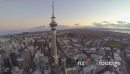 300m high aerial pan of sky tower and the auckland waterfront go 4975