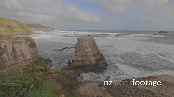 Cinematic dolly shot from a hill facing Muriwai Ocean side 4994