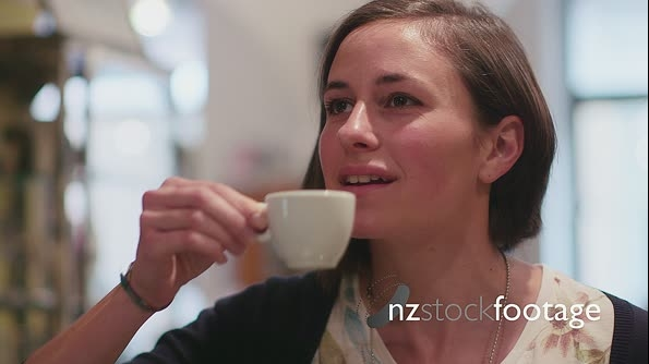 Young Woman Drinking Espresso Coffee In Bar 5156