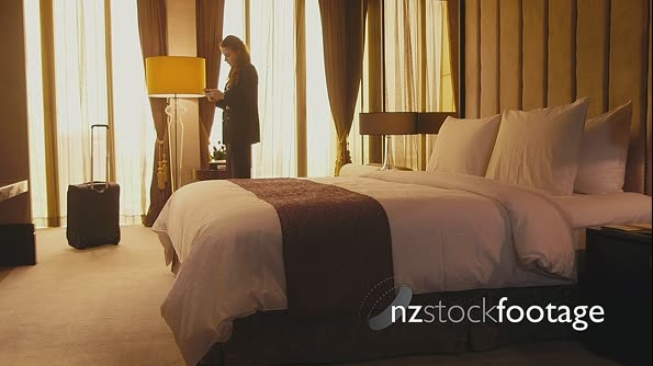 Businesswoman With Smartphone For Internet, Email In Hotel Room 5171