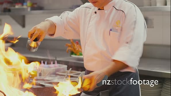 Professional Asian Chef CookingIn Restaurant Kitchen 5175