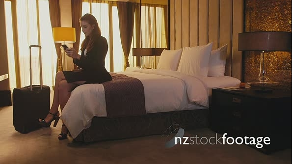 Business woman Working WithS martphone In Hotel Room 5176