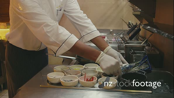Professional Chef Preparing Food In Restaurant Kitchen 5185